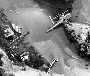 Aerial view looking down on the wreckage of helicopter which crashed into river bed on a movie location near Castaic, California on Friday, July 23, 1982 killing veteran actor Vic Morrow and two Vietnamese child actors with him. (AP Photo)