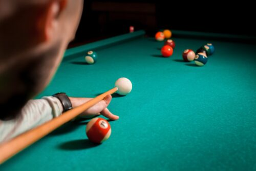 Fragment of the pool billiard game in process. American pool billiard. Pool billiard game. Billiard sport concept.